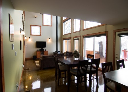 Living and dining area with floor to ceiling windows